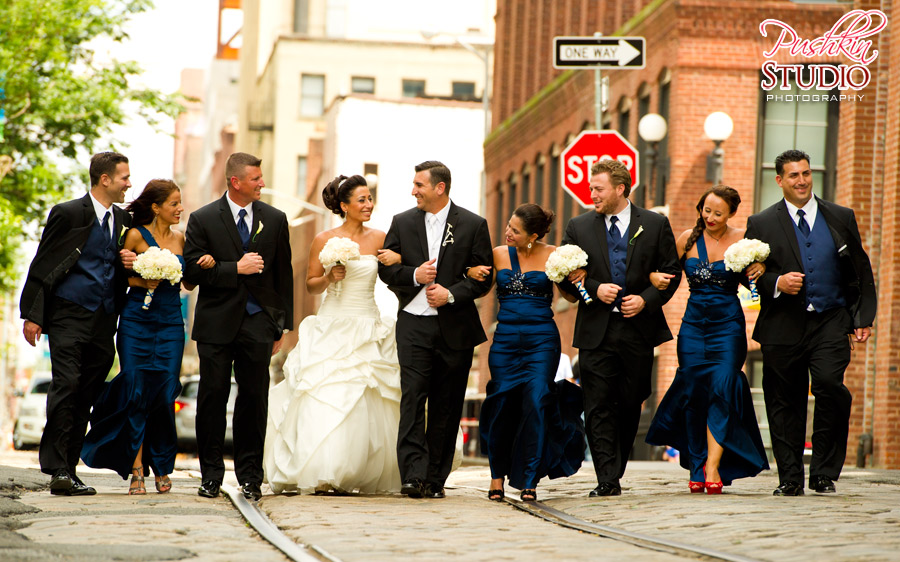 Bride, groom, and bridal party walking in Dumbo